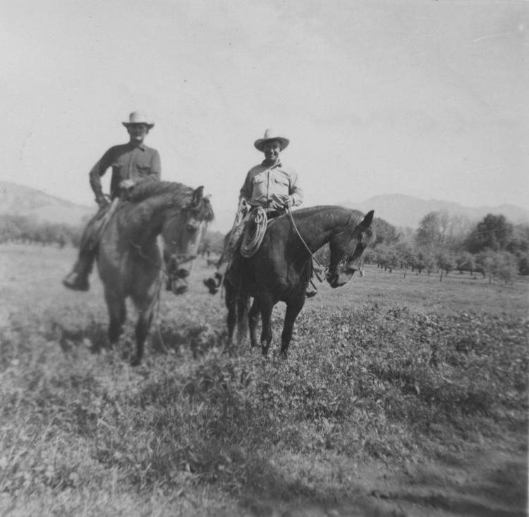 Leonard and hand on horseback